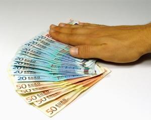 Hand auf Geld